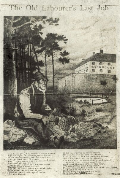 An old man sits breaking stones while a workhouse looms behind