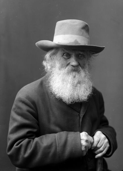 An old man with beard, stock and hat, 1910. Date: 1910