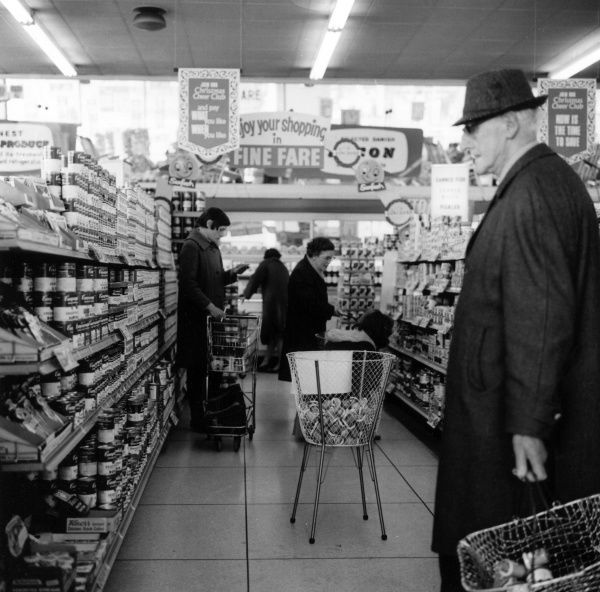Elderly man shopping in a Bristol Fine Fare supermarket. Date: 1968