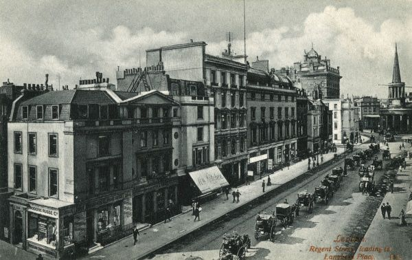 View of the Old Polytechnic Building in Regent Street, leading up to Langham Place, London. The spire of All Souls Church, Langham Place, can be seen in the distance on the right. Date: circa 1910s