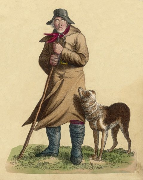 An old shepherd looking thoroughly dejected as he stands in the cold with his sheepdog