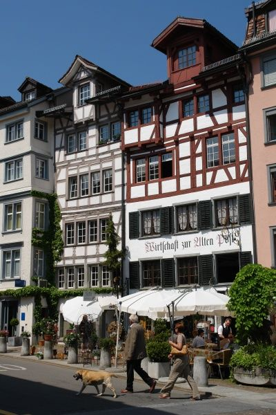 View of some old, timber-framed buildings with a restaurant on the ground floor in the old part of St Gallen, Switzerland