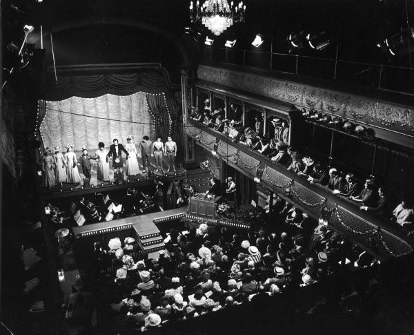 The cast of the Old Time Music Hall show from the City Varieties in Leeds take a bow; the audience, dressed in Victorian and Edwardian costume, are part of the show Date: 1960s