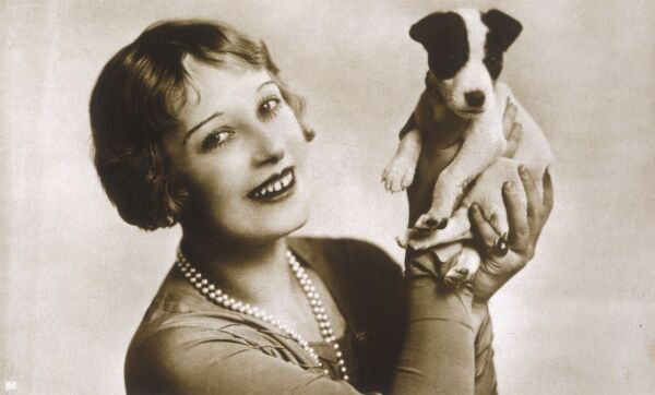 OLGA LINDO Anglo-Norwegian character actress in British films, seen here with her dog