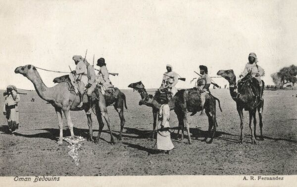 Omani Bedouins riding their camels, Oman