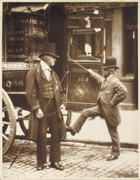 A Victorian omnibus driver assists a gentleman passenger to board the No 568 (route between Edgware Road and West Strand)