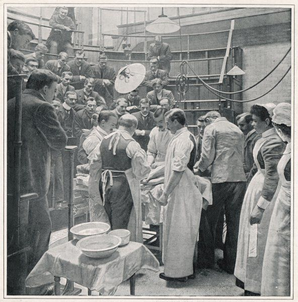 An operation at Charing Cross Hospital, London, watched by students and colleagues