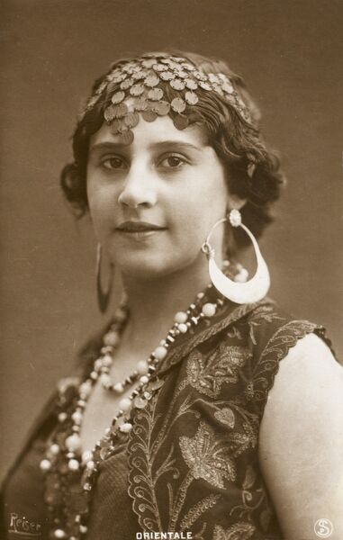 An Ottoman beauty from Egypt, with large hooped earrings, beads, headdress and floral jerkin
