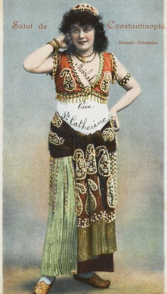 An oriental Turkish beauty from Constantinople - possibly a dancer. in highly decorated outfit with raised motifs and tassles