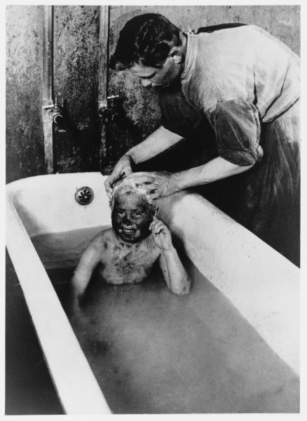 A filthy Russian orphan is given a thorough bath