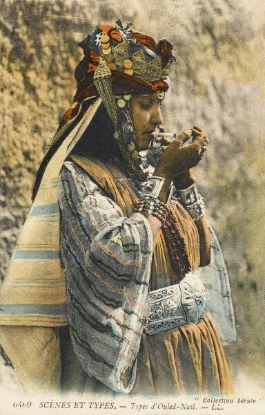 Woman from the tribe of Ouled Nail in Southern Algeria in their very distinctive and elaborate traditional clothing. The women earned money through belly dancing. The women are heavily made-up, going unveiled at all times and wear their hair up