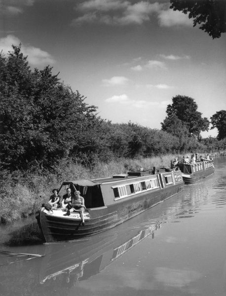 Two converted narrow boats 'Mandy' and 'Nelson', cruising on the Oxford Canal, near Lower Shuckburgh, Warwickshire, England. Date: early 1960s