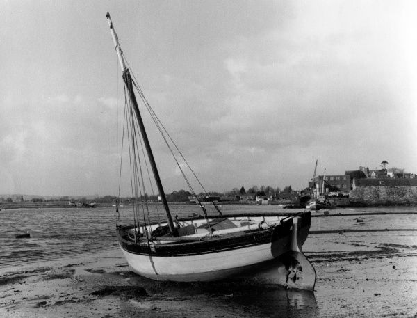 An oyster boat at the side of the River Exe in Topsham, Devon