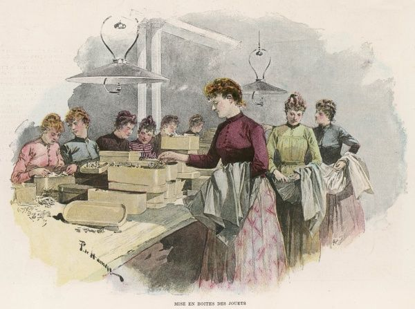 Female workers pack toys in a factory
