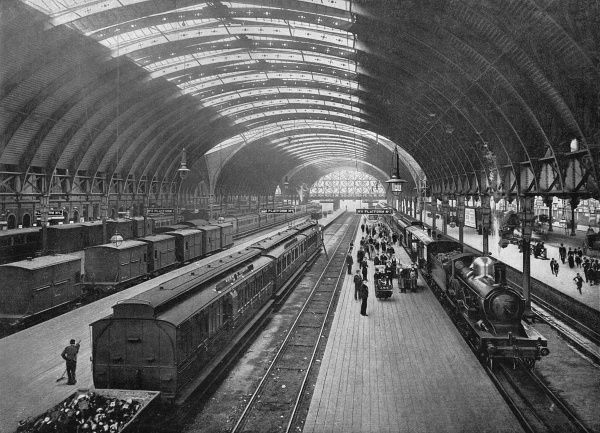 View of the platforms, with goods as well as passenger trains. Date: 1901