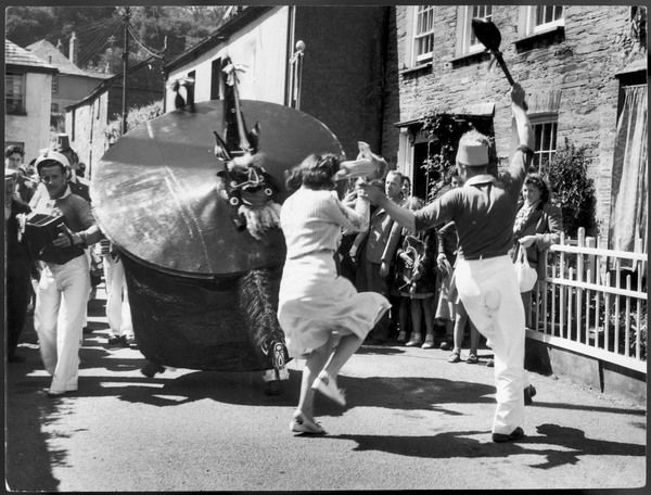 ENGLAND: PADSTOW HOBBY HORSE: MAY DAY. 'Oss, teaser & attendants dance. Any woman caught under the frame of the 'Oss will become pregnant before the end of the year