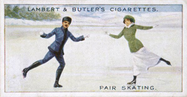 A man and woman skate together on the ice