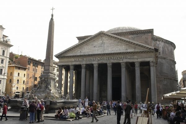 View of the entrance to the Pantheon, with a fountain in the piazza in front. The Pantheon was built by Marcus Agrippa as a temple to all the gods of Ancient Rome, and rebuilt by the Emperor Hadrian in about 126 AD