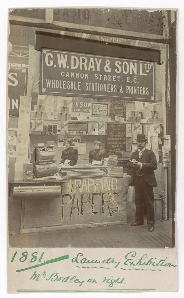 "The exhibition stand of G W Dray & Son Ltd at the Laundry Exhibition, with ""Mr Bodley on the right&quot"