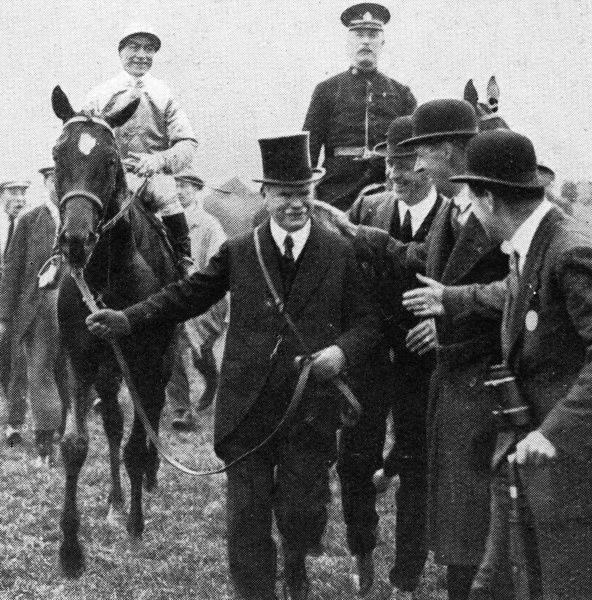 Mr B. Irish leads in his horse, Papyrus with jockey Steve Donoghue up, following its win in the 1923 Derby at Epsom. For Donoghue it was a third successive win in the race. Date: June 1923