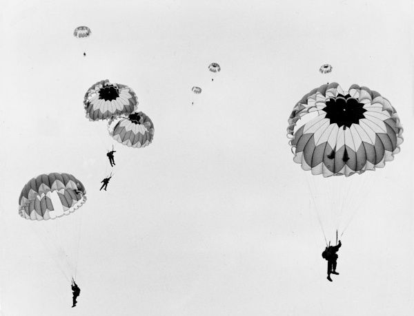 Sky divers are relieved when their parachutes open at 2000 feet above ground. Date: 1960s