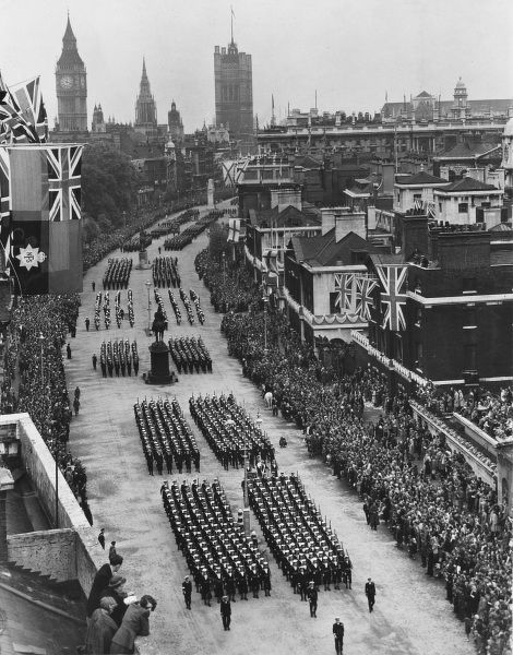 View of the Metropolitan Police Band marching down Whitehall in Central London during victory celebrations to mark the end of the Second World War