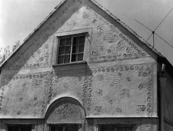 A fairly modern example of the ancient technique of pargetting (decorative plasterwork), seen on a house at Takeley, Essex, England. Date: 1950s