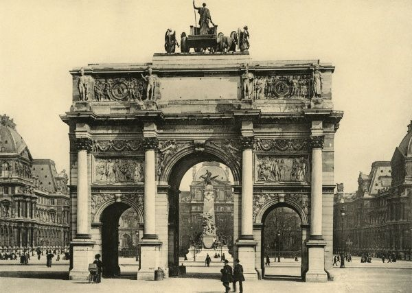 This arch stands between the Louvre, which you can see beyond it, and les jardins des Tuileries, which lie behind us. It serves no useful purpose but looks impressive. Date: circa 1904