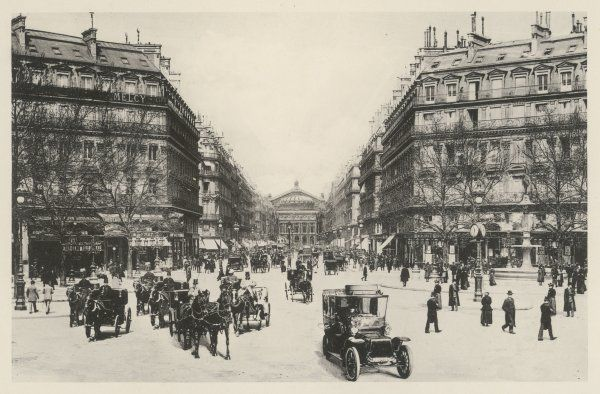 Avenue de l'Opera: photograph showing both cars and horse-drawn carriages on the streets of central Paris