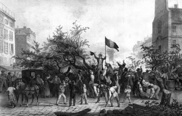 In the Paris streets, trees are felled to build a barricade to prevent troops advancing : the tricouleur waves proudly over the heads of the insurgents. Date: 1830
