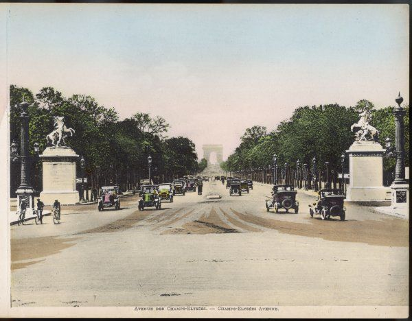 Avenue des Champs Elysees, with cars, and a few cyclists