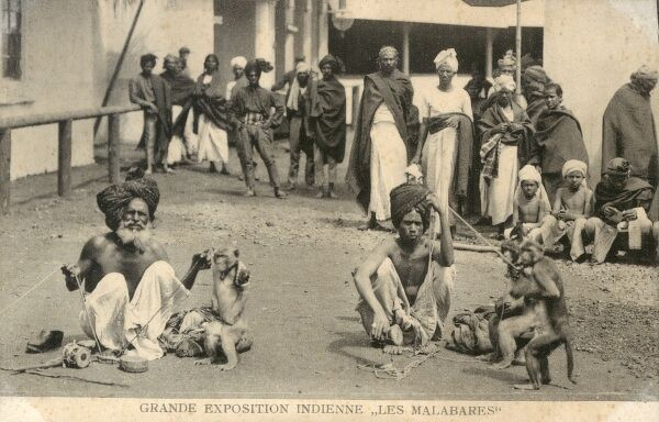 People from the Malabar region of southern India (lying between the Western Ghats and the Arabian Sea) at the 'Grande Exposition Indienne' held in Paris in 1902. Here two men perform with dancing monkeys. Date: 1902