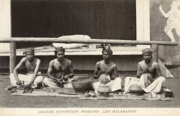 People from the Malabar region of southern India (lying between the Western Ghats and the Arabian Sea) at the 'Grande Exposition Indienne' held in Paris in 1902. Four Malabar men paint and decorate pots and produce other craft wares