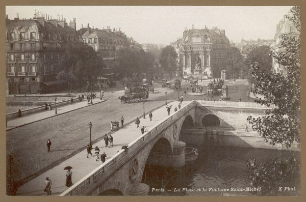 An aerial view over a bridge to the fountain of Saint- Michel