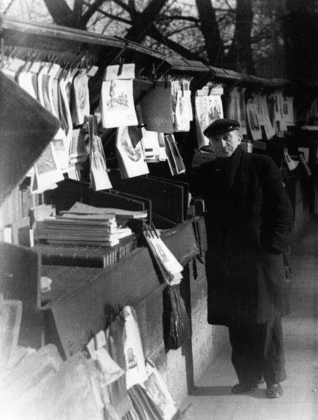 A fair number of the pictures in our files were purchased from the bouquinistes whose stalls form a permanent book and print market lining the quais of Paris. Date: 1930s