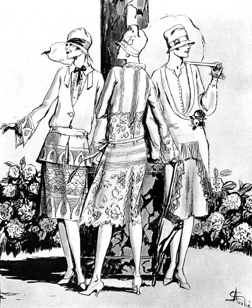Three stylish dresses, designed for wearing at the races, 1926. On left: A suit of rose alpaca, embellished with a white motif, worn with a white blouse and a neat black tie. Centre: A white linen dress decorated with tiny pleats and embroidery