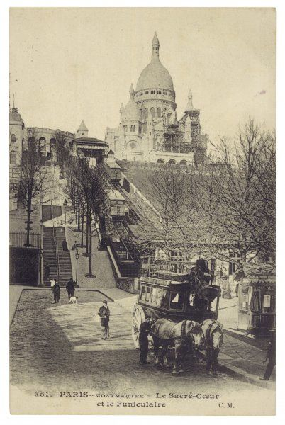 A horse bus waits at the foot of the Montmartre funiculaire, which still carries sightseers and worshippers to the church of Sacre Coeur