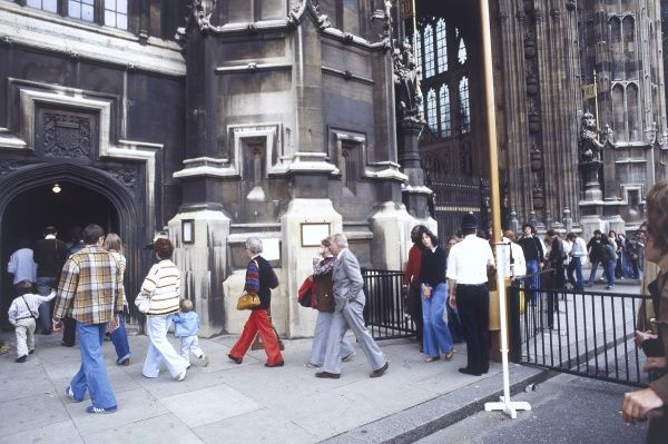 Tourists walking around the Houses of Parliament, Westminster, central London. Date: 1978