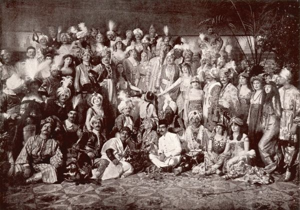 "A group of revellers in lavish fancy dress at a party hosted by la comtesse de Clermont-Tonnerre. The costumes look very Oriental in theme, perhaps influenced by the Ballets Russe and their performance of ""Sheherazade"" during this period"
