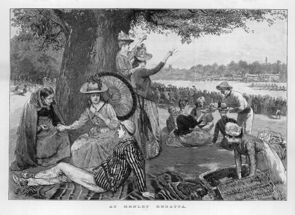 A party of people picnicking at the Henley Royal Regatta, an annual rowing event held on the River Thames near the town of Henley-on-Thames, South Oxfordshire. A gipsy fortune teller provides some alternative entertainment (left)