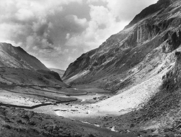 A striking view of the Pass of Llanberis, Caernarvonshire, which traverses a valley of exceptional wildness, between Snowdon and the Glyder Mountains