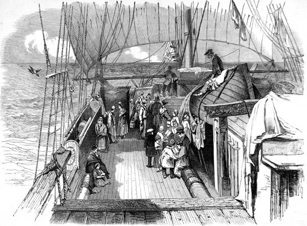 Engraving showing emigrants on the deck of their ship, at sea, 1849. A group of children are being taught their lessons by a school master whilst a small crowd gathers around the ship's galley