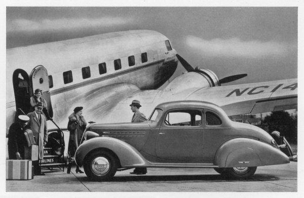 A Hudson drives right up to the aeroplane to pick up arriving passengers