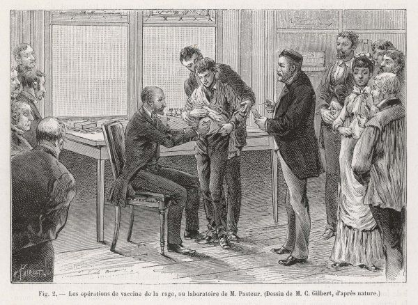 Louis Pasteur (1822 - 1895), French chemist and microbiologist, supervises a vaccination against rabies in his laboratory