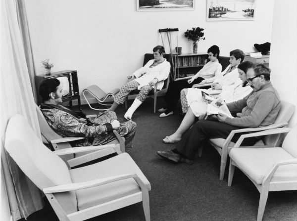 Scene at the Metropolitan Police Medical Centre, Hendon, north west London, showing patients relaxing with visitors in a rest room