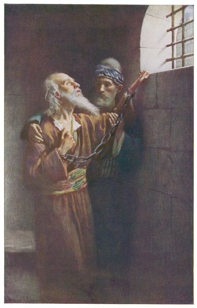St Paul's Last imprisonment. Depicted in chains he looks towards the window of his cell. (2 Timothy: IV 6-22)