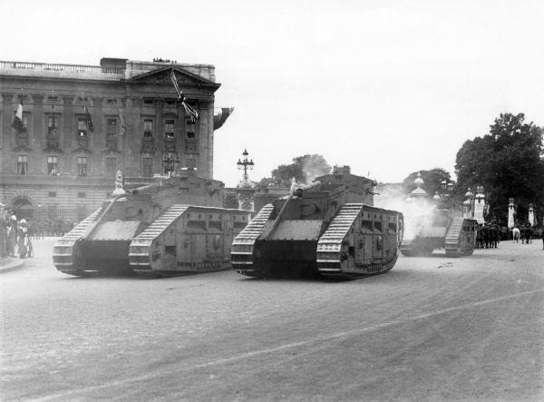 Tanks with their guns lowered, taking part in Peace Day Celebrations outside Buckingham Palace, London. Date: 19 July 1919