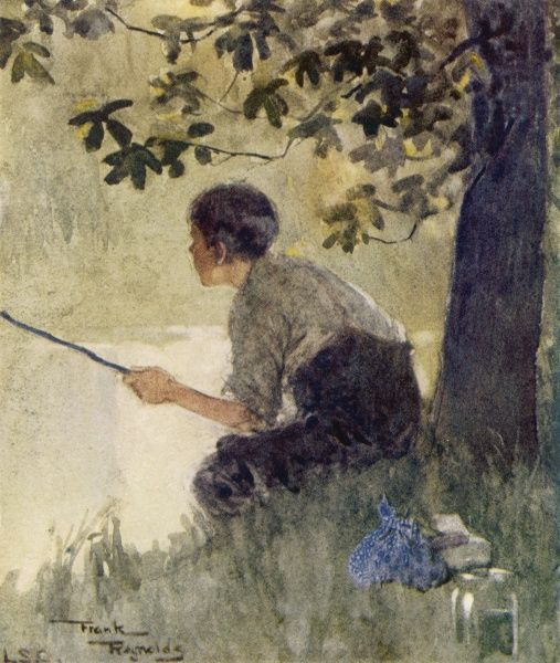 A young boy sits peacefully fishing