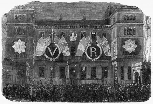 Fireworks and illuminations cheered the populace on the cessation of hostilities in the Crimean War. In this engraving the Ordnance Office, Pall Mall, London is illuminated with images of the garter and the Queen's insignia, VR. Date: 1856