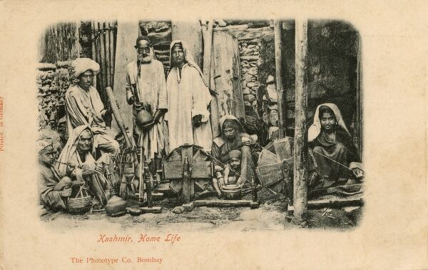 A beautiful very early photographic postcard showing a peasant Family in Kashmir, Northern India